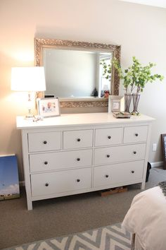 large mirror hung over the dresser