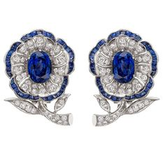 Sapphire & Diamond Flowerhead Earrings | From a unique collection of vintage brooches at https://www.1stdibs.com/jewelry/brooches/brooches/