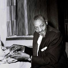 Sonny Boy Williamson eating fish and chips in one of his Saville Row suits.