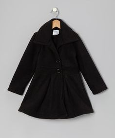 Crafted from snuggly fabric, this swingy button-up coat is the perfect layer for keeping cuties comfy-cozy.