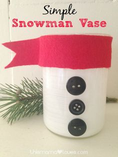 Simple Snowman Vase Craft- really cute, ,easy to do, and perfect to bring some fresh flowers to a holiday gathering! (Also just plain cute for your own house)