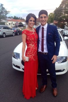 Amanda Spiteri looks lovely in her red prom dress. Lace dress with chiffon skirt and high leg slit.