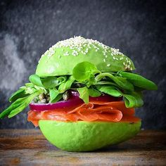 Loaded Smoked Salmon Sandwich on an Avocado Bun - with Truffle Mayo (in the avocado pit holes), Capers, Red Onion and Lettuce ⭐️ by @fooddeco ⭐️ Join our culinary community on Cookniche.com for free and share your photos, recipes and blogs...