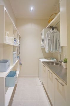 hanging rack above sink -- great idea contemporary laundry room by Natalie Du Bois