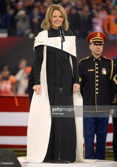 Opera singer Renee Fleming performs the National Anthem during the Pepsi Super Bowl XLVIII Pregame Show at MetLife Stadium on February 2, 2014 in East Rutherford, New Jersey.
