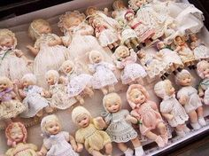 Dollies in rows. Reminds me of a museum I went to.