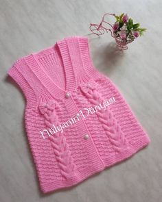 No photo description available. Crochet Baby Dress Pattern, Knit Baby Dress, Knitted Baby Cardigan, Knitted Baby Clothes, Kids Knitting Patterns, Knitting For Kids, Baby Knitting, Cardigan Bleu, Diy Crafts Knitting