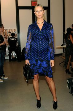 Karolina Kurkova wears a floral and polka-dot mixed print DVF dress with black ankle booties