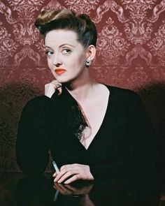 "Bette Davis in a color shot as Charlotte Vale in ""Now, Voyager"" (untouched)"