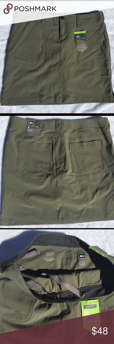 REI travel skort Northway Travel skort in pewter green, is brand new with tags. REI Skirts Mini