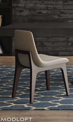 The woven fabric of the Mercer chair is hand-stretched across the tapered back and wing-like arms (armchair option). Available as either Side Chair or Arm Chair, both in Silver Birch fabric upholstery.