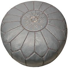 @Overstock - This handmade Moroccan leather pouf ottoman has been beautifully hand-stitched by skilled artisans in Morocco. Taking about seven individual artisans to create, this pouf also features a lovely grey color.  http://www.overstock.com/Worldstock-Fair-Trade/Leather-Grey-Pouf-Ottoman-Morocco/5710565/product.html?CID=214117 $198.99 (entry way)