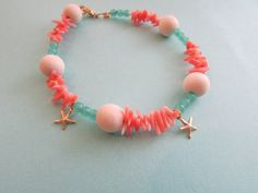 Beachy Jewelry/Coral Bracelet /Seafoam Green Czech Glass /Gold Filled Starfish Charms /White Wood Beads / Sea Inspired Jewelry on Etsy, $15.00