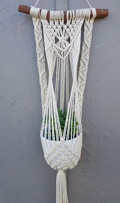 Check out this item in my Etsy shop https://www.etsy.com/au/listing/621943311/macrame-pot-hanger-vintage-decor