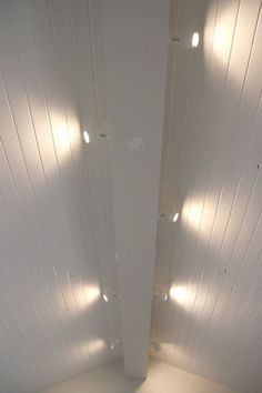 track lighting installed to wash the vaulted ceiling with light and provide indirect ambiance over g