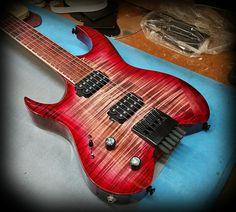 Kiesel Guitars Carvin Guitars  V6 (Vader headless series) in deep red cali-burst and Kiesel treated fretboard