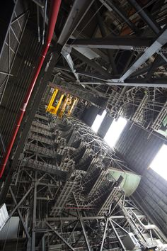 High up in the Vehicle Assembly Building (VAB) at NASA's Kennedy Space Center in Florida, a crane lowers the second half of the B-level work platforms, B north, for NASA's Space Launch System (SLS) rocket, for installation in High Bay 3. The B platform will be installed on the north side of high bay. In view below are eight levels of previously installed platforms. The B platforms are the ninth of 10 levels of work platforms that will s...
