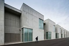 Completed in 2012 in Baltar, Portugal. Images by Nelson Garrido. Located in the middle of a school and sports complex, this building differs from the other schools as it offers a wider programme, catering for...