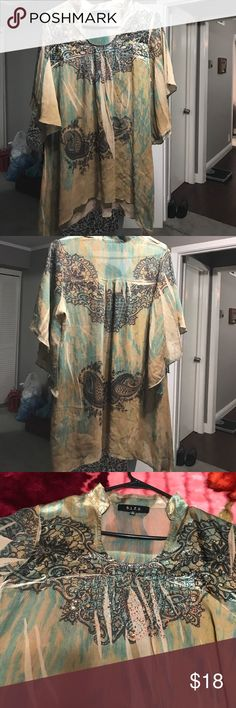 very cute top printed top in shades of green with diamonte work on neckline. Neck is u shaped and high collar. The sleeves and the hem line is in butterfly shape B .L .E.U. Tops Blouses