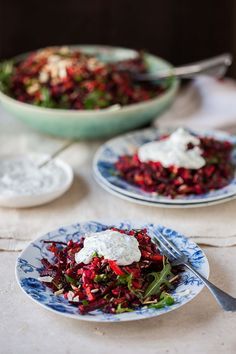 raw beetroot and carrot salad with herbs, almonds, sunflower seeds