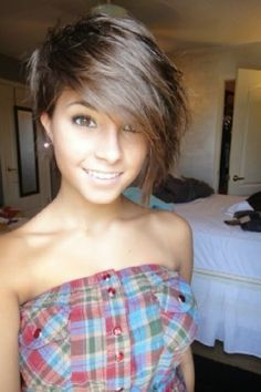 Pixie cut with long side bangs...want this cut, shoulder length and not so much pulled forward. I adore the layers!