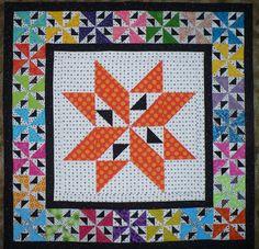 Barb Johnson's Pinwheels on Parade quilt based on Bonnie Hunter's Pinwheel Fancy block.