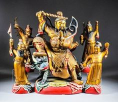 """A large Chinese carved polychrome and giltwood seated figure of a bearded Weather Deity seated on a mythical beast with billowing robes, his right hand raised brandishing a sword, two fingers raised on his left hand, on painted cloud base, 20.25ins (51.4cm) high, and four similar standing figures of acolytes - Lei Kong, the """"Duke of Thunder"""", 15.375ins (39cm) high, Tian Mu, the wife of Lei Kong, 13ins (33cm) high, Yu Shi, 14.125ins (36cm) high, and a bearded deity, thought to be the """"Wind…"""