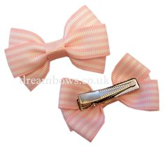 Baby pink and white striped grosgrain ribbon hair bows on alligator clips - www.dreambows.co.uk