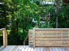 slatted cedar fence with rolling gate