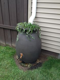 think about cutting down costs for irrigation this summer by adding a simple water barrel - Decorative Rain Barrels