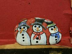 Snowmen rock painting