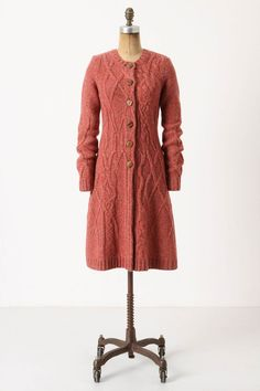 I like the idea of a knitted coat, but I'm not sure I like the asymmetry in the cables.