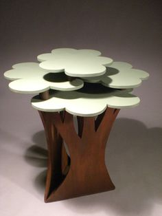 Such a cute table for a nursery! Thought of you storey it matches the tree shelf your dad made :)