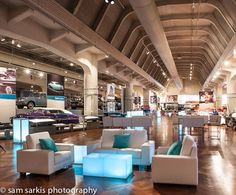 Loving how they used white modern furniture within Henry Ford Museum's Car Court.  Now that is a fun cocktail hour!