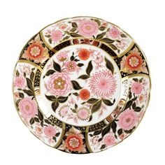"""A stunning interplay of intricate design and gorgeous color, serving as both salad and dessert plates. From the famed Royal Crown Derby, which traces is origins to the original factory set up in Nottingham Road around 1750 and later granted permission to include the title """"Royal"""" in the company name by Queen Victoria in 1890. Made of the finest English Bone China.    Measures 8 ½"""" d."""