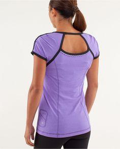 Shoulder pleats, cutout, ruffled reflective ribbon trim.      Team Spirit Tech Short Sleeve. Lululemon.