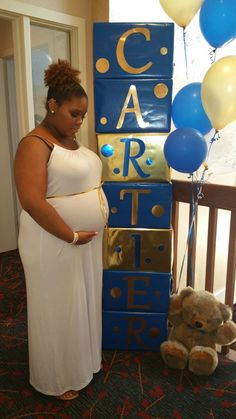 Baby shower name blocks in royal blue and gold.