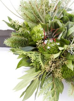 Beautiful winter wedding bouquet! By Belle Fiori Florist in Milwaukee, photography by Twin Lens Weddings #twinlensweddings #milwaukeeweddingphotography #weddingbouquet #weddinginspiration #greenbouquet #greenerybouquet
