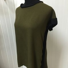 "2 tone loose fitting Olive top with black trim This is a great top with its butterfly type sleeves and black trim down the sides. Very ""forgiving"" of those extra lbs! Size tag was removed but fits a med/large Zara Tops Blouses"