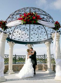 gazebo decoration option....this is a nice idea to soften the pillars and add color with flowers...