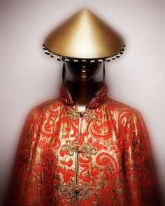 1977-78 - Yves Saint Laurent  Couture Coat of red silk and gold metallic brocade; hat of gold leather. Courtesy of Fondation Pierre Bergé–Yves Saint Laurent, Paris