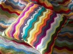 Inspiration: ripple cushion. I had been wondering how to make a square when the edges are rippled. I like how they sorted this out by crocheting a long piece of ripple, folding in 3 pieces, joining at the sides and adding button fastenings.