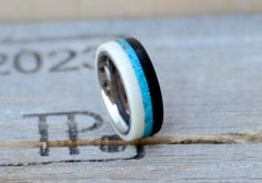 This ring is Synthetic Ivory, Turquoise, and African Blackwood Inlay. Additional…