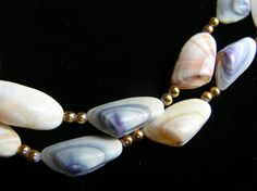 Vintage coquina shell by 2VintageGypsies on Etsy.. I would love a bracelet