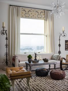 This living room's custom window coverings and low-slung sofa frame a spectacular view of the San Francisco Bay. The eclectic space, which features a mix of patterns and textures, relies on neutral accessory colors for warmth.