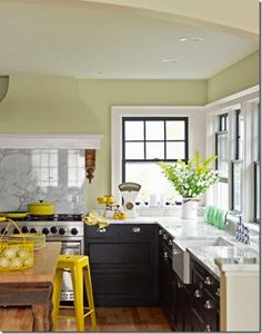 Most kitchen remodels I see on-line have white or cream-colored cabinets.  We were thinking of keeping ours dark, with a wall color like this.  I don't think we'd use a gray marble, though - we're thinking one (or a laminate) that's creamy with lots of flecks of brown and black...