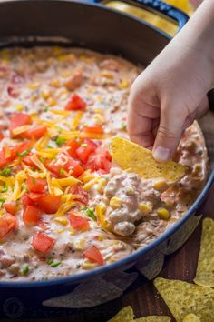 Sausage Queso Dip is creamy, cheesy and irresistibly good! A queso dip recipe with real cheddar cheese, loaded with sweet corn and tomato. A party favorite!