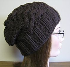 This warm and stylish beanie is designed with cables that come to a peak rather than crossing over. Wear it slouchy or fold up the brim and make it a fitted beanie! However you wear it, its a warm, fast knit! Makes a great gift for men, women or teens!