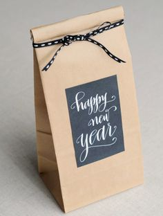 Happy New Year! Cute party favor bag. Could fill with items your guest might enjoy using to ring in the new yr. ... sparklers, party horn, wine glass charm, etc...
