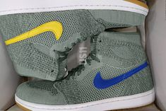 Air Jordan 1 Retro High Flyknit Clay Green Features Alternate Colored Swooshes